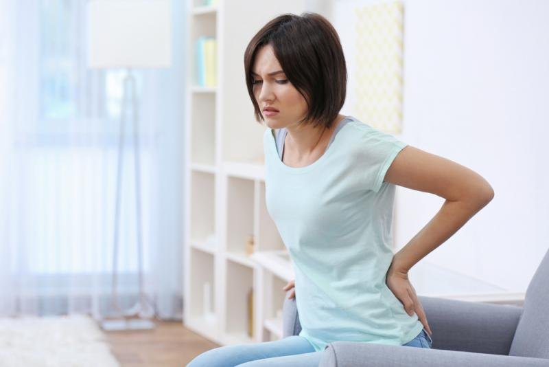Woman with lower back pain due to degenerative disc disease